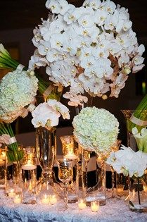 A chic tablescape includes orchids and hydrangeas.