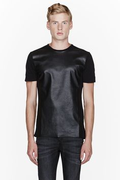 NEIL BARRETT //  Black faux-leather paneled t-shirt  32368M041005  Short sleeve relaxed-fit t-shirt in black. Crewneck collar. Tonal faux-leather panel at front with raw edge at front hem. Tonal stitching. Body: 100% cotton. Front: 100% polyester. Machine wash cold. Made in Portugal.  $335 CAD