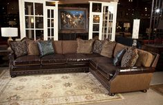 Fabric and leather sectional sofa. Great for media room. All pillows are included.  Western art. Living room at Brumbaugh's 817-244-9377