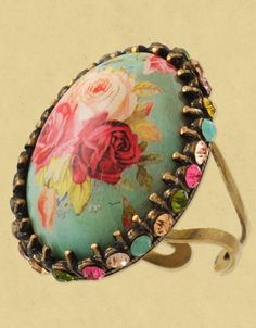 Handmade Michal Negrin vintage inspired oval shaped talisman ring. The ring is made from brass with a printed cameo surrounded by Swarovski crystals.
