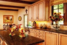 A Spanish Kitchen   I see clean lines on the cabinets with detail work. The color is burnt orange with like the wood &' lightning .