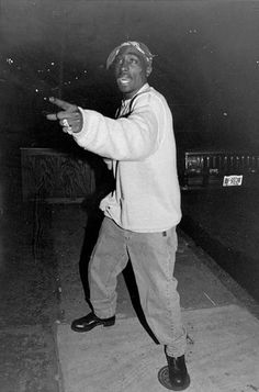 Tupac Shakur look tall in this picture.