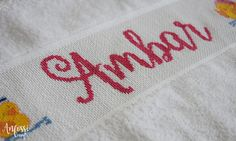 Towel with Hand embroidered personalized name. Cross stitch.