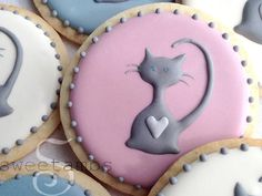 "If you saw my last tutorial on how to make cat cookies, you probably already know that I really like cats. To make these cookies, I piped a rough shape of a cat with gray icing and then used the scribe tool ""draw"" the details. Scroll down to the vid"