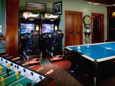 A fully decked out basement that looks more like an arcade than a basement with the foosball table, nascar games and an air hockey table. See other great man caves by clicking on the image. Arcade Game Room, Game Room Bar, Game Room Basement, Man Cave Basement, Arcade Games, Game Rooms, Basement Bathroom, Playroom, Million Dollar Rooms
