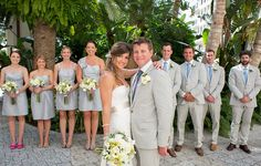 Light suits in grey and blue for the groomsmen. Just another idea.. May go better with bridesmaid dresses?
