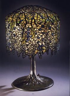 Tiffany Studios, A Fine Wistaria Leaded Glass and Bronze Table Lamp