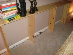"Make a behind-the-sofa table for under $20. Only need 3 or 4 pieces of wood, some ""L"" brackets, and wood stain (I already have that).  I could totally make this myself."