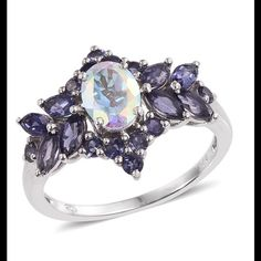 Mercury Mystic Topaz, Iolite 2.90 CTs Mercury Mystic Topaz, Iolite 2.90 CTs  Ring features a gorgeous 1.40 CT Oval accented with 1.50 CTs of beautiful Catalina Iolite. Ring is done in Platinum Overlay .925 Sterling Silver Nickel Free (Size 8.0) TGW 2.900 CTs. Such a pretty ring. Jewelry Rings