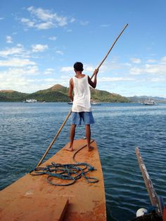 Coron boatman drifting around Busuanga island in the Province of Palawan, Philippines