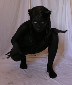 Demon.  This was my Halloween costume one year (the pic isn't me).  But  called myself a shadow person.  I want to do it again.