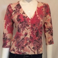 """Ann Taylor Floral 3/4 Sleeves Sweater Ann Taylor Floral 3/4 Sleeves Sweater. V Neck Button Down. (7 buttons). Size Medium. 60% Nylon, 30% Angora Rabbit Hair, 10% Lambs Wool. Measurements: Armpit to Armpit 18.5"""", Length 21.5"""", Sleeves16"""". Some pilling on the sweater. Ann Taylor Sweaters"""