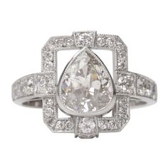 """Pear Shape Buckle Ring - 1.36ct H/I1 Pear shape diamond set in a platinum hand crafted """"Single Stone"""" mounting."""