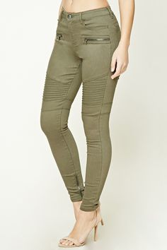 A pair of skinny jeans featuring a mid-rise fit, zippered accents on front, ribbed knees, seam-stitched panels, zippered ankles, a five-pocket construction, and a zip fly.