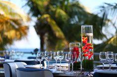 Tropical flower centerpieces for beach wedding. // Wedding coordination by Leanne Marie Weddings.  Photo By Rachel Schrank of Playaweddings