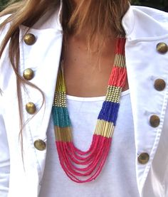 Want this jacket! The necklace is pretty neat too!