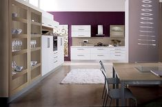 modern white kitchen furniture with dark purple wall. Like the wood cabinet for displays.