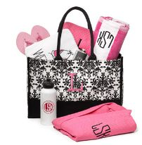 Idea::Swag Bag with Monogrammed beach towel, Magazine, flip flops, lotion, water bottle, a treat and something local