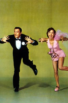 "Gene Kelly and Debbie Reynolds portray the characters of Don Lockwood and Kathy Selden respectively in the movie ""Singin' in the Rain""......wearing the costumes from the song ""all I do is dream of you""."