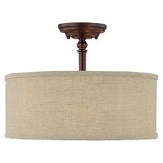Bronzed semi-flush mount with a fabric drum shade.       Product: Semi-flush mount   Construction Material: Meta...