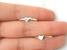 * This cute ring is great for everyday wear or for special occasions. * Available in 2 colors - silver and gold * Size: US 5 &6 * Please note that the dark spots shown in the pictures are not damages;