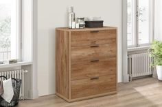 The Stockwell range provides a touch of reclaimed design to any home. It's rustic oak effect finish and sleek black handles create a truly rustic range. Farmhouse Furniture, Rustic Furniture, Luxury Furniture, Luxury Loft, Chest Of Drawers, The Ordinary, Storage Spaces, Cosy, Tall Cabinet Storage