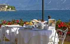 """See 4 photos and 3 tips from 22 visitors to Hotel Baia D'oro. """"A must for a 5 star meal in Gargnano. Attentive service and excellent cuisine and wines"""" Italian Lakes, Hotel, Lake View, Wines, Table Decorations, Gold, Wine Cellars, Lake Garda, Center Pieces"""