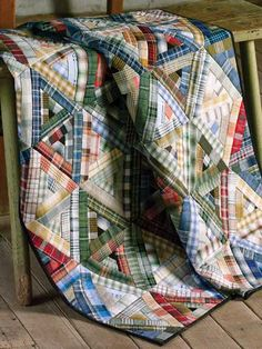 Use paper foundations to piece accurate triangle-shaped Log Cabin blocks with woven plaids in a variety of colors. This e-pattern was originally published in Inspiration for Precuts.