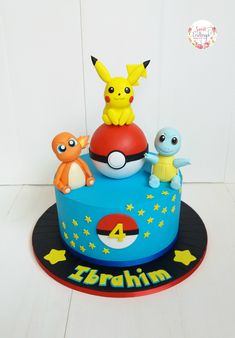 Pikachu, Charmander and Squirtle for this Pokemon cake!
