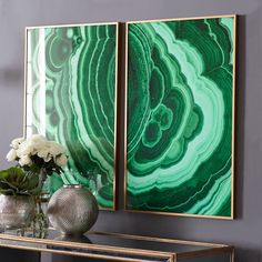 Malachite Wall Art.  Designed in-house by the team at Wisteria, this print personifies the healing element of nature. The rich green hues pop against neutral walls, while the flow of the lines deliver a unique energy to a space.