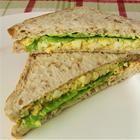 Egg salad sandwich: mayo, mustard, chopped green onion, paprika, salt, pepper...pickles too?