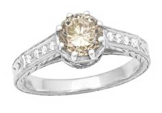 A unique alternative to a white diamond engagement ring, this one of a kind Art Deco carameldiamond engagement ring in 18K white gold features a stunning natur