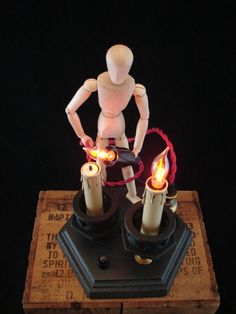 One of my very favorite artists!!   I have his mannequin hand sconces & looking forward to more like these :0) Upcycled Vintage Lamp Parts Artist Figure Lamp by BenclifDesigns