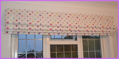 A really pretty Roman blind made using the curtains that used to hang here!