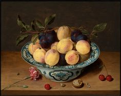 Isaac Soreau (Hanau 1604 - after 1638) ,A still life with peaches and plums in a dish.