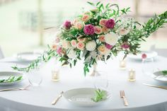 Garden Wedding - HOLY WOW centerpiece!! Sunkissed Blooms floral design photographed by Lyndsey A Photography at Ashley Inn in Kentucky. Wedding florals with lots of lush greenery and garden-inspired natural textures.