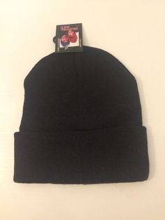 53e74dff646432 a black tam, beanie, skull cap that may be used during the winter to keep  your head warmer. brand is gloves hat, and it is made in china. it is new  and ...