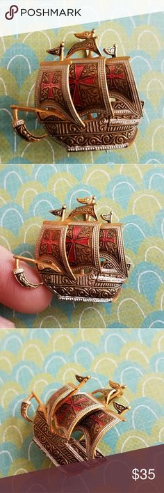 Vintage Spain sailing ship boat brooch gold This awesome vintage Spanish ship brooch is made of gold tone metal with black and red enamel faux Damascene designs. It is signed SPAIN on the back. This pin is in great vintage condition with some light surface wear, nothing major! From a smoke free home:)   8188ship8j6f Vintage Jewelry Brooches