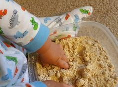 Sensory learning: Homemade sand! blended up gram crackers & oatmeal. My 9 month old loved it. I need to get some sea shells!