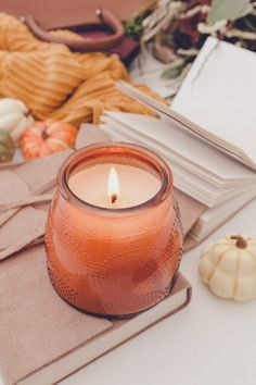 Want to get your home feeling cozy and festive? Here are our top 5 Fall decorating ideas to turn your place from summertime fresh to cozy Fall. #FallDecor #FallDecoratingIdeas #HomeDecorIdeas Scented Candles, Candle Jars, Candle Holders, Fall Scents, Fall Candles, Modern Farmhouse Decor, White Pumpkins, Warm Colors, Stationery