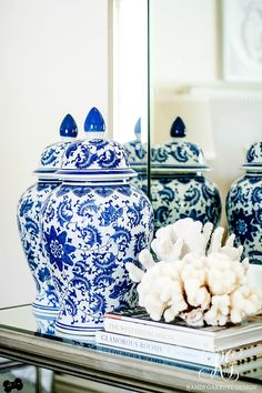 30 Tips for Summer Decorating - Simple Tips to style your Home for Summer. Summery white coral, pretty books, blue and white ginger jars