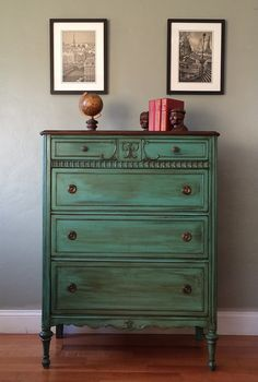 THIS PIECE IS SOLD AND IT IS SHOWN HERE AS AN EXAMPLE OF THE TYPE OF WORK WE DO. PLEASE CONTACT US IF INTERESTED IN ORDERING A SIMILAR PIECE. WE CURRENTLY HAVE SEVERAL PIECES SIMILAR TO THIS ONE AVAILABLE FOR CUSTOM ORDERS IN ANY COLOR OF YOUR CHOICE.  Beautifully restored 1920s chest of drawers painted and distressed on a teal tone and finished with a hand rubbed walnut glaze made by General Finishes. All of our pieces are sealed with multiple coats of General Finishes top performance…