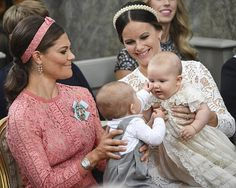 Prince Alexander of Sweden held by his mother Princess Sofia (right) at his baptism on 9 September 2016. Pictured with his aunt, Crown Princess Victoria and her youngest child, Prince Oscar.