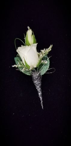 White rose bout with hunter and silver accents