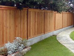 I like the idea of the fence on concrete footer - adds height, animals can't dig under & will slow water rot.