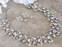 This beautiful necklace and earring set can be made with an inconspicuously placed tiffany blue crystal incorporated into its design to act as the bride's ʺsomething blueʺ item or be made with all clear crystals.  www.blueluckbridal.com