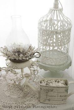 Shabby chic display - lantern, antique birdcage and white tin