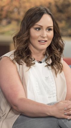 Chanelle Hayes strips down to a bikini to show off her size 16 curves...