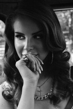 this is a photo of Lana Del Rey the photoagrapher is unknown and its from someones tumbler called http://scprep.tumblr.com i love the split lighting on her face