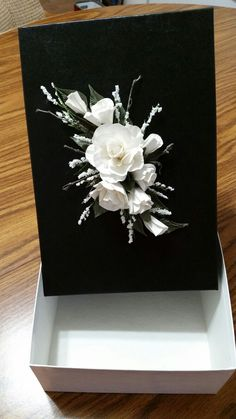 White roses decorated gift box